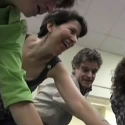 Lisa Levine-Bernstein leads the laughter class for her small group of laughing students, including her husband, Ed Bernstein.