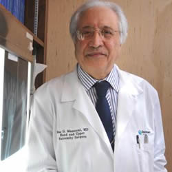 Dr. Mas Massoum believes that a positive attitude and consciously switching to positive thought could distract our brains from feeling pain.